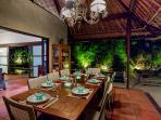 Tropical style dining under traditional 6m high Alang Alang and Bamboo ceiling