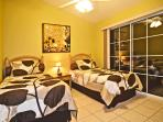 Twin Bedroom with Flat Screen TV and DVD Player