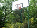 Regular basket ball hoop in barbecue-pool area