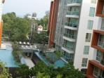 view of condominium and sea from balcony
