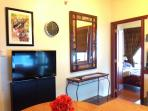 Recent photo: Additional wall decors, wall clock with the LCD TV, oriental console table and mirror