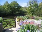 The garden gate opens onto the riverbank