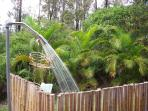 Outdoor shower with hot and cold running water. Day, night, rain or shine, always refreshing.