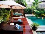 relax on sun loungers by the pool