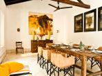antique dining table and leather chairs comfortably seating 8 people