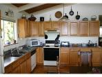 Kitchen, with antique draw leaf table, seats 4-8