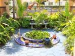 Sunken courtyard with koi pond