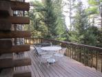 Deck off the Dining Area overlooks Chain Lake - Gas Grill & 2 dining tables with chairs