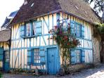 Medieval house in Gerberoy, a most flowered village of France, vehicles prohibited