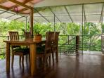 Upper terrace dining room with room for 6 view of ocean and jungle