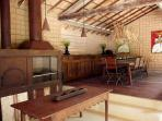 dining room with barbecue and pizza oven