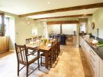 The breakfasting Kitchen and four oven Aga with an American fridge freezer separate hob and oven