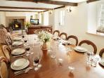 The Dining Area at Hause Hall Farm with an antique mahogony table and seating for 14