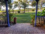 Farmhouse Front Patio looking at the grape vines