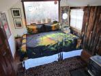 This sweet cabin has a closet, table, chairs, coffee maker, sink, commode, and big windows.