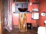 Bathroom with cedar log sink