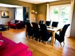 Spacious dining room with additional sofa bed and ipod docking station