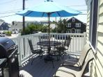 OUTSIDE DECK WITH TABLE AND CHAIRS AND DECK UMBRELLA - GAS GRILL WITH FULL TANK OF GAS