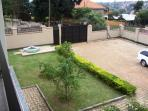 Balcony view of compound and car parking area