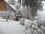 a winter scene of the house and approach