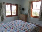 Across the breezeway is a second queen size bedroom. With windows on both exterior walls, the view is amazing. The...