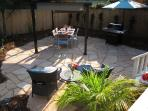 Recently Landscaped Backyard Entertainment Area with Flagstone Patio and Pergola