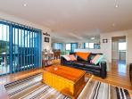 Open sunlit living, dining & kitchen area. Perfect for watching the whales and wildlife