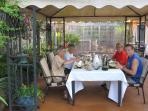Guests enjoying breakfast under gazebo