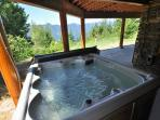Private Hot Tub on the lake side of the cabin!