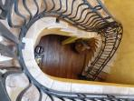 Elegant stone staircase leads to sleeping accomodations