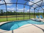 South facing pool with lake and woodland conservation views