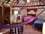 An authentic Mayan Hut converted into a room - Hammock in the room -
