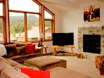Spacious Living Room with Granite Surround Fireplace & TV