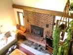 View of living area and fireplace from loft