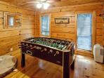 Game room with as foosball table and dart board