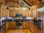 Beautifully furnished kitchen with all granite counter tops
