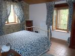 The Spontini Room with  double bed and bathroom. Possibility to join an extra bed.