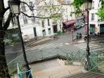 View of our street entrance from the bridge 'Passerelle de la Grange aux belles' over the canal
