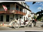 A carriage goes by the St Francis Inn
