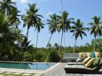 Sun loungers on pool deck