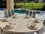 Table with 6 chairs on pool deck