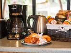Complimentary coffee, tea, pastries and fruit welcome our guests
