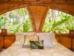 Bedrooms have high thread count sheets and beautiful tropical ginger growing right outside the window