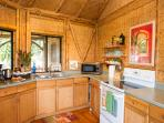 Fully stocked kitchen and outdoor gas grill make cooking a pleasure