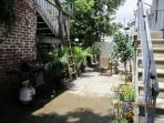Spacious and Shady Patio, Out Door Shower, Dining Table, Palm Trees and more