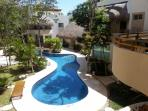 This is the view of the pool and garden area from the front entrance and balcony of Mariposa Azul.