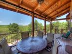 Hugh Hill Country views 20' covered back deck with seating for 8.