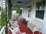 Enjoy a cup of coffee on the porch at Book Nook Inn B&B