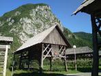 Hayracks under the hill and village Studor