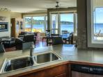 Your view from the kitchen into living room, dining room and the ocean